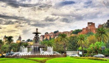 Tres Gracias Fountain and Alcazaba Castle in Malaga